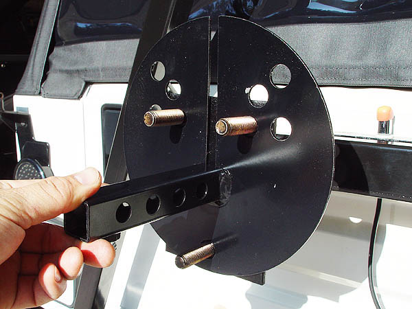 Remove Your Jeepu0027s Spare Tire And Slip On The Rock Hard License Plate  Relocation Bracket On To The Mounting Studs. Reinstall Your Spare Tire.
